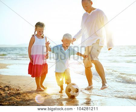 Family Playing Football Beach Summer Concept