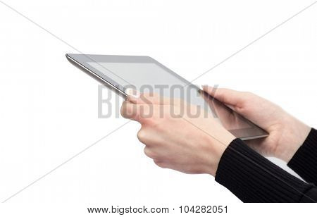 hands holding the tablet computer