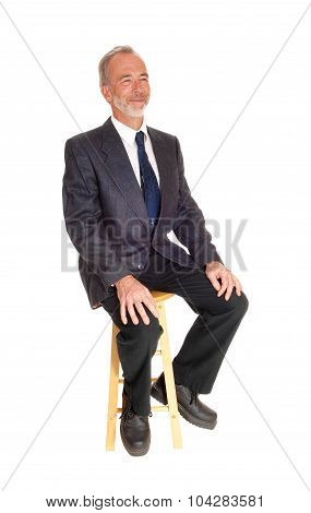 Middle Age Professional Man Sitting On A Chair.