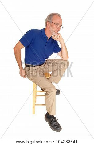 Old Man Sitting On Chair Thinking.