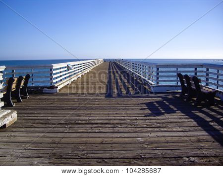Two Benches Overlook The Ocean On California Pier