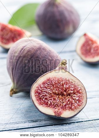 Ripe fig fruit on the wooden table. Macro shot.