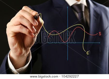 Businessman with financial graphic coming from hand