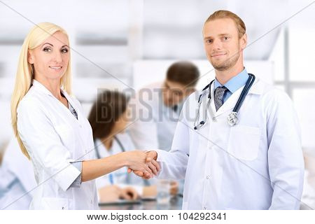 Medical workers shaking hands and  people
