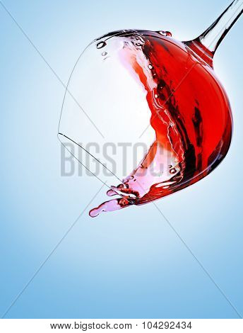 Falling glass of red wine