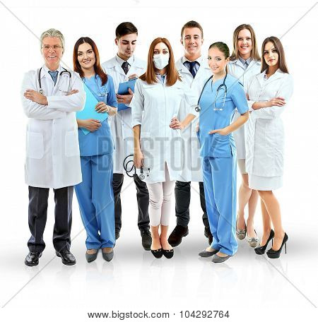 Group of smiling medical doctors isolated on white