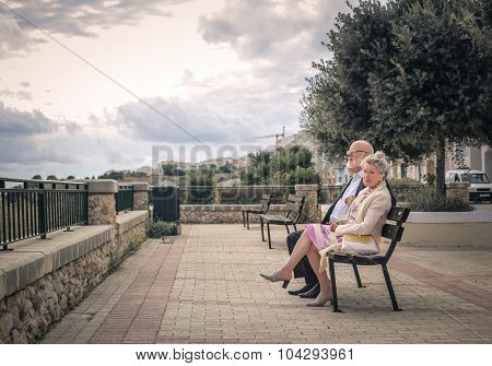 Couple sitting on a bench at the park