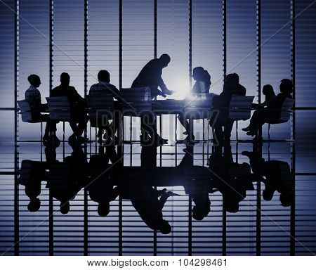 Silhouettes of business people in a conference room Concept