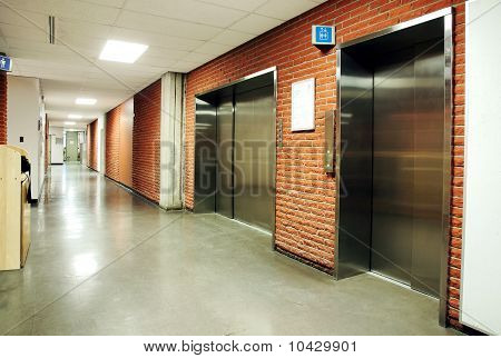 Steel Door Elevators In Deserted Hallway