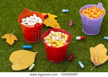 Pills and pharmacy.Autumn harvest in buckets