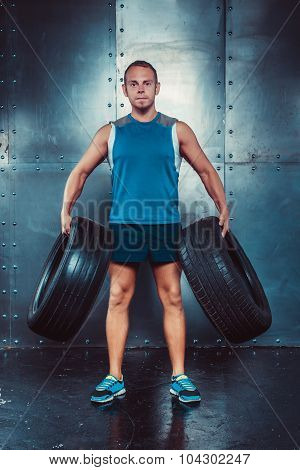 Sportsmen. Fit Male Trainer Man Keeps The Car Tires, Concept Fitness Workout Strenght Power