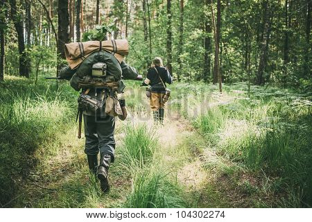Unidentified re-enactors dressed as German soldiers running thro