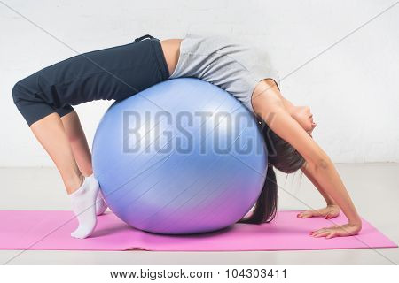 Beautiful Sport Woman Doing Fitness Exercise, Stretching On Ball. Pilates, Sports, Health.