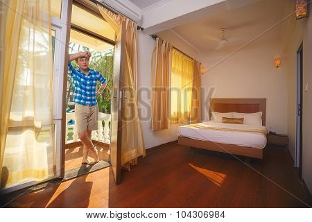 Young tourist  standing at hotel looking for room