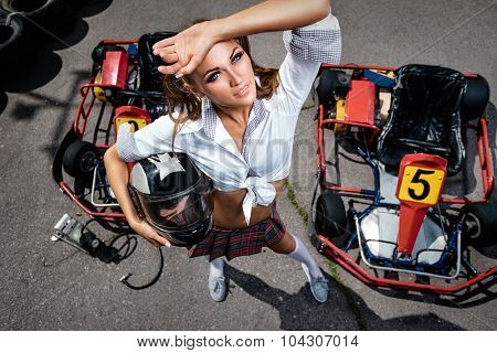 Girl  with helmet in carting