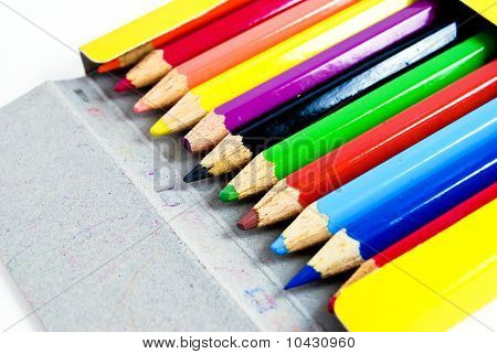 Color Pencils In Yellow Box On White Background