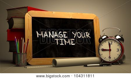 Handwritten Manage Your Time on a Chalkboard.