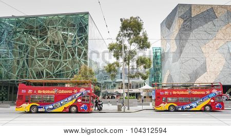 Two Sightseeing Open Top Buses In Melbourne