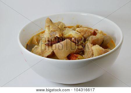 Tom yum pork knuckle in bowl