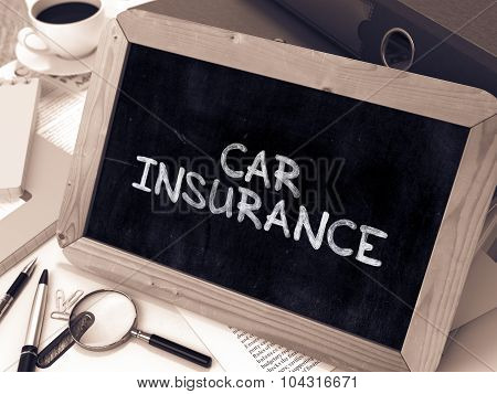 Car Insurance Handwritten by white Chalk on a Blackboard.