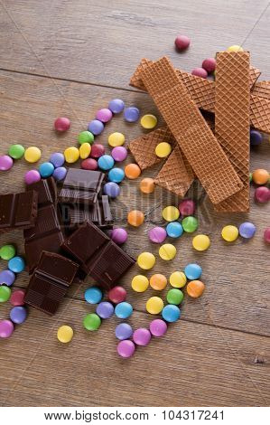 Colorful Smarties Among Chocolate And Biscuits
