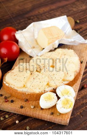 Slices Of Aromatic Cheese On Buttered Bread