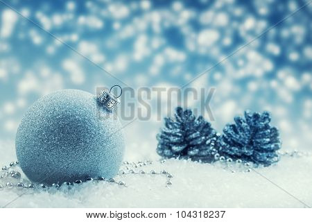 Luxury Christmas ball with ornaments in Christmas Snowy Landscape. Christmas time.