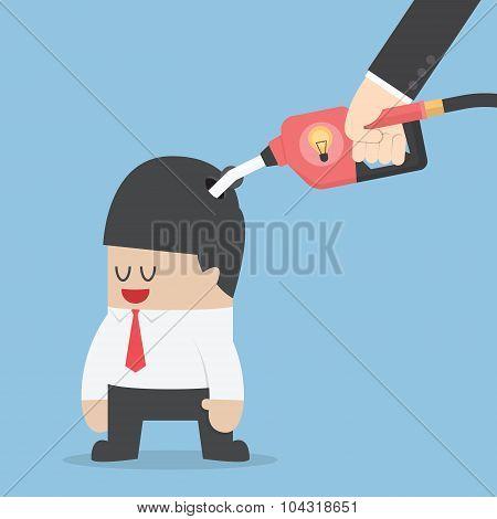 Businessman Refuelling His Idea By Fuel Nozzle