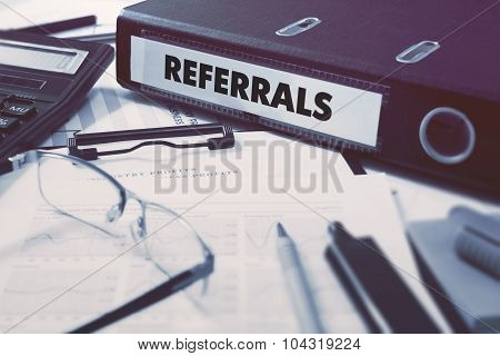 Referrals on Ring Binder. Blured, Toned Image.