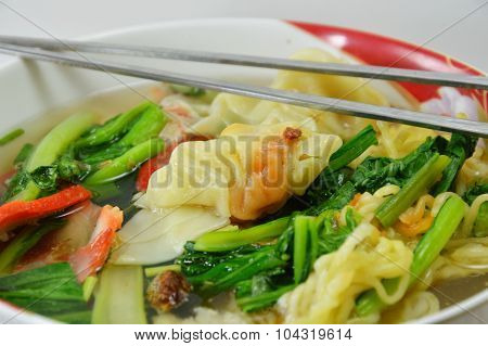 Chinese noodle with barbecue pork and wanton with soup on bowl