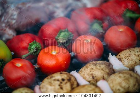 Veggies on barbeque tomatoes, red bell pepper, potatoes