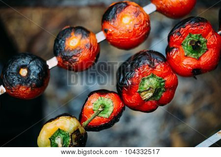 Veggies on barbeque: tomatoes, red bell pepper