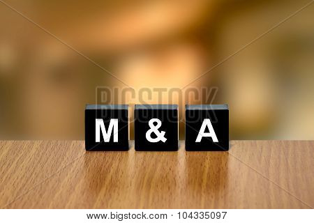M&a Or Merger And Acquisition On Black Block