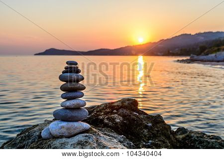 Turret Pebbles At Sunset With Ocean On Background. Relaxing Stones