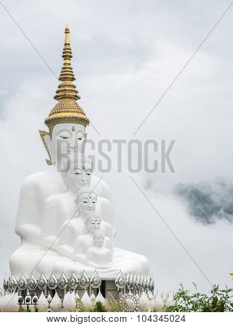 Big Five Sitting Buddha Statues In A Mist, Thailand