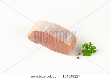 chop of raw pork tenderloin on white background