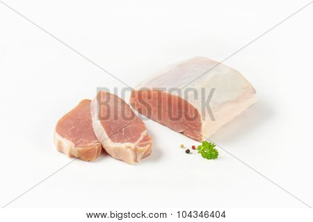 chopped raw pork tenderloin on white background