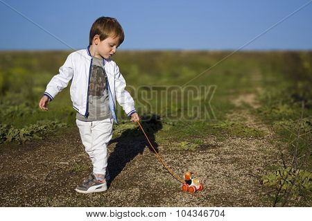Child with the dog on a leash