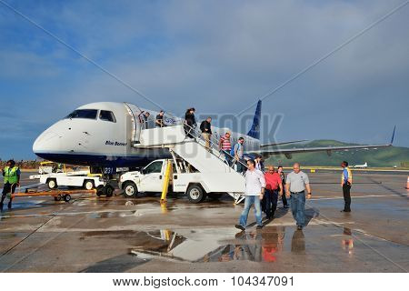 ST THOMAS, VIRGIN ISLANDS - JAN 7: Passengers unboard airplane on January 7, 2013 in St Thomas, Virgin Islands. Cyril E. King Airport is the busiest in the United States Virgin Islands
