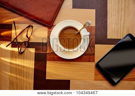 Coffee cup with glasses and tablet pc on table retro vintage