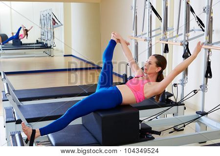 Pilates reformer woman short box tree exercise workout at gym indoor