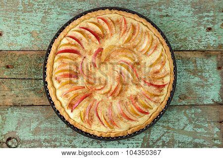 Homemade Round Apple Tart On Vintage Wooden Table