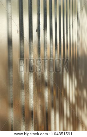 Corrugated metal fence with zinc coating