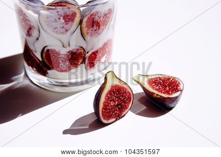 Rox With Milk And Figs; One Half Split Fig On White Table Under Natural Direct Sunlight