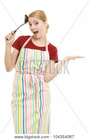 Housewife Or Cook Chef In Kitchen Apron With Ladle