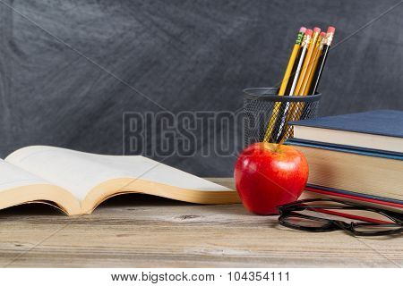 Desktop With Reading Materials And Blackboard