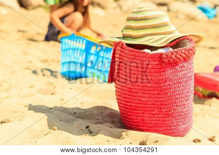 Wicker Handbag Bag And Hat On Summer Beach.
