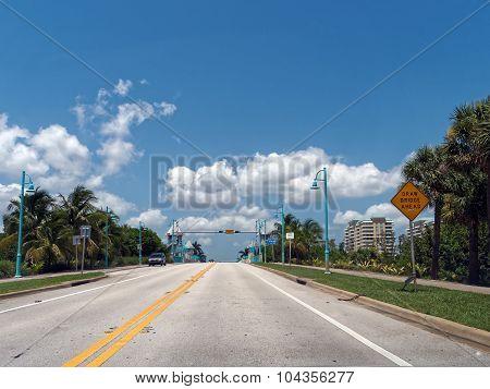 Driving Under Blue Skies Towards Draw Bridge