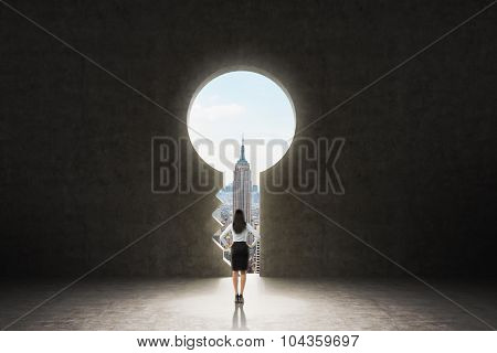A Keyhole In The Concrete Wall. A Business Lady Dressed In Formal Suit Is Looking At New York City I