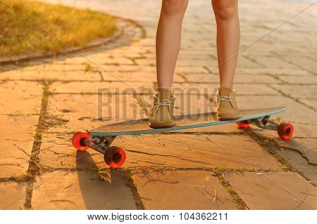 Nice girl riding skateboard
